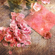Vintage heart from flowers on wooden table — Stock Photo #13920887
