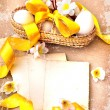 Easter eggs and branch with flowers on paper — Stock Photo