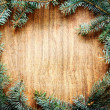 Christmas fir tree on a wooden board — Stock Photo