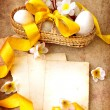 Easter eggs and branch with flowers on paper — Stock fotografie