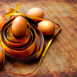 Easter egg with colorfull ribbon as a nest — Stock Photo