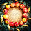 Stock Photo: Christmas tree with apples and decorations on wooden board