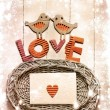 Vintage holidays card with a two birds and hearts as a symbol of love - Foto Stock