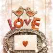 Vintage holidays card with a two birds and hearts as a symbol of love - Stok fotoğraf