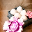 Easter eggs in the box with a flowers and cards for the sign - Stock Photo