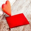 Valentines Day background with heart and holidays gift on old wooden background with two candle - Foto Stock