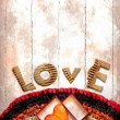 Vintage holidays card with heart as a symbol of love - Foto Stock