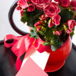 Holiday bouquet of red flowers on black  chear - Stok fotoğraf