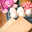 Easter eggs in the box with a flowers and cards for the sign — Stock Photo
