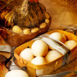 Hen with easter basket on paper background — Stock Photo