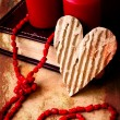 Valentines Day background with heart on old background with two candle - Stock Photo
