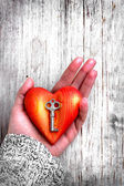 Heart with the key in women hand as a symbol of love — Stock Photo