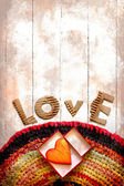 Vintage holidays card with heart as a symbol of love — Stock Photo