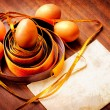 Easter egg with colorfull ribbon as a nest - Stock Photo