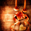 Valentines Day background with heart and holidays gift on old wooden background with two candle. — Stock Photo #24967997