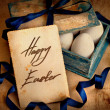 Vintage card with box with easter eggs - Stock Photo