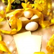 Easter background with Easter eggs with spring flowers, vintage easter card with basket — Stock Photo #24969215