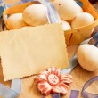 Stock Photo: Easter basket on paper background, easter holidays card