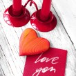 Valentines Day background with heart and holidays gift on old wooden background with two candle — Foto de Stock