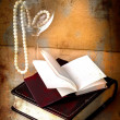 Retro picture of a necklace lying on a book — Stock Photo