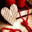 Valentines Day background with heart on old background with two candle — Stock Photo