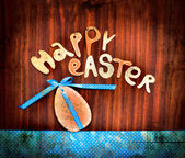 "Easter eggs with lettering ""happy easter"" on textured background — Stockfoto"
