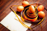 Easter egg with colorfull ribbon as a nest — Stockfoto