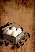 Vintage box with easter eggs — Stock Photo