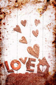 """Vintage holidays card with a house and heart as a symbol of love, valentines day card with word """"love"""" — Stock Photo"""