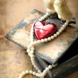 Two pigeons and red heart as symbol of love — Stock Photo