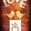 "Vintage holidays card with a two birds and heart as a symbol of love, valentines day card with word ""love"" — Stock Photo"