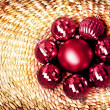 Christmas decoration on vine woven basket, christmas ornaments on natural wicker background. — Stockfoto