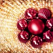 Christmas decoration on vine woven basket, christmas ornaments on natural wicker background. — Stock Photo