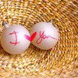 "Two baubles with words ""I love you "" and heart on vine woven basket — Stock Photo #24973269"