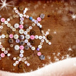 Decorative christmas background with buttons as snowflake, snowflake on dark rusty wooden background — Stock Photo