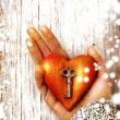 Stock Photo: Heart with the key in women hand as a symbol of love