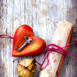 Key with the heart ,rose and letter as a symbol of love — Stock Photo #24975103