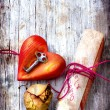 Key with the heart ,rose and letter as a symbol of love — Stock Photo #24975227