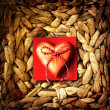 Heart on vine woven basket - Stock fotografie