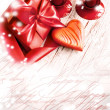 Valentines Day background with heart and holidays gift on old wooden background with two candle — Stock Photo #24975967
