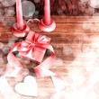 Valentines Day background with heart and holidays gift on old wooden background with two candle — Zdjęcie stockowe