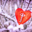 Vintage card with red heart on the snow tree branches - Foto Stock