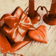 Valentines Day background with heart and holidays gift on old wooden background with two candle. — Foto de Stock