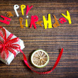 Royalty-Free Stock Photo: Vintage gift box (package) with words happy birthday on wooden background