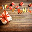 Vintage gift box (package) with words happy birthday on wooden background — Stock Photo