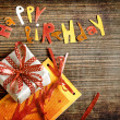 Vintage gift box (package) with words happy birthday on wooden background — Stock Photo #24979357