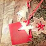 Christmas decoration over grunge wooden background — Stock Photo #24979499