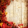 Stock Photo: autumn frame from ashberry and maple leaves on wooden plates with grunge texture