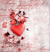 Heart as a symbol of love, vintage card with red heart and dry roses on grunge old background — Stock Photo