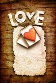 Tarjeta de vacaciones vintage con corazón como un símbolo de amor — Foto de Stock